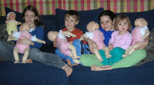 An older picture of my children and my infant mannequins